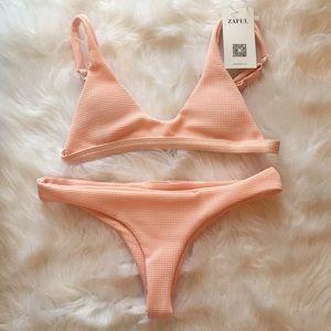 Zaful pink textured bikini 👙 in size medium (6).
